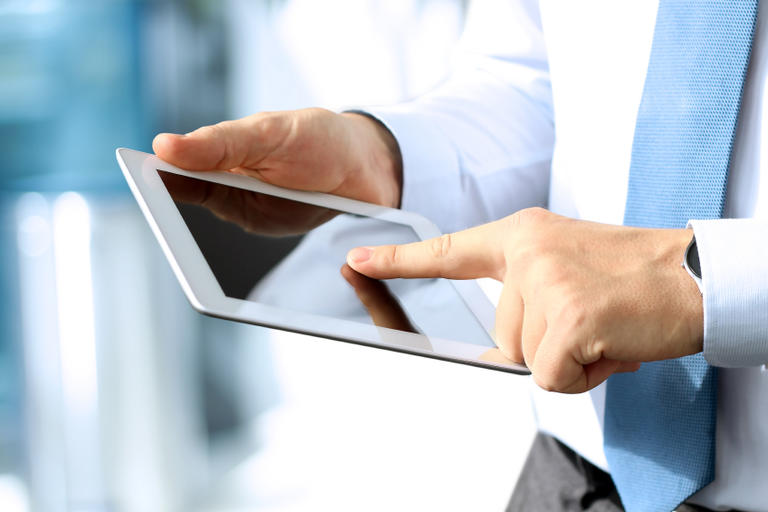 Image of person using a tablet